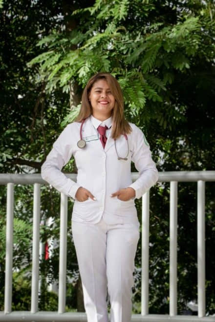 A white female doctor in white hospital uniform wondering how to sell services online