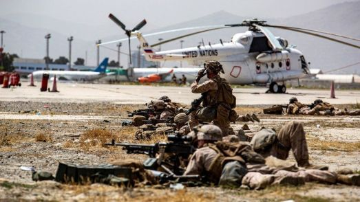 IMAGE SOURCEREUTERSimage captionUS soldiers have been guarding Kabul airport