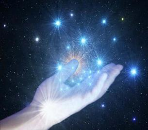 Hand holding cosmic starseeds