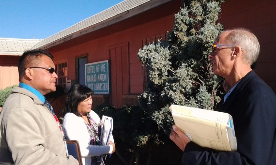 Navajo Nation John Billison tlaks to his attorney, Henry Howe, outside the Labor Commission hearing room in Window Rock, Ariz., on Sept. 24, 2013. Photo by Marley Shebala