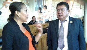 Navajo President Shelly's staff attorney Heather Claw and Council Delegate David Tom at the Council special session in Window Rock, Ariz., on Oct. 16, 2013. Photo by Marley Shebala
