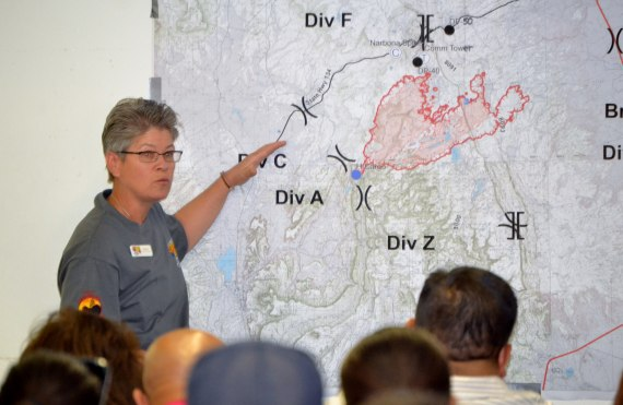Southwest Incident Management Team 3 Commander Bea Day emphasizes to all attendees at Assayii Lake Fire briefing at 9 a.m. that the fire was still very dangerous because high winds made it unpredictable. The daily fire briefings at 9 a.m. were moved from the Navajo Museum in Window Rock, Ariz., to the Field House in Fort Defiance, Ariz., which is also the SW Incident Command Center. Photo by Marley Shebala.