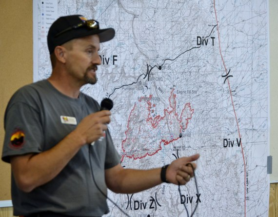 "Dave Gesser, who heads the daytime SW Incident Management Team 3 Operations Sections, reported that the reduction in wind is allowing for more air suport in containing the Assayii Lake Fire. The SWIMT 3 holds daily briefings at 9 a.m. at the middle school ""tin house"" in Fort Defiance, Ariz. Photo by Marley Shebala,"