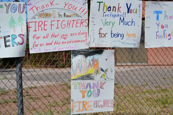 "These ""thank you"" signs are among numerous other that are posted across from the entrance to the Southwest Incident Management Team 3 Command Center at the Field House in Fort Defiance, Arizl, on June 20, 2014. Photo by Marley Shebala. (Please give proper photo credit when reusing photo.)"