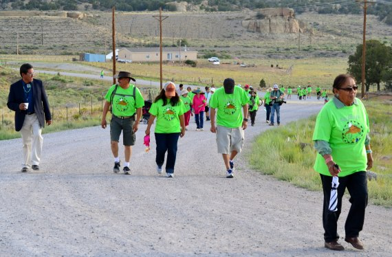 Navajo Council Delegate Russell Begaye, far left, took part in an early morning walk from the Red Water Pond to the site of a 1979 radioactive disaster. The walk was part of the 35th commemoration of the 1979  catastrophe on July 19, 2014. Photo by Marley Shebala. (Please provide proper photo credit when reusing photo.)