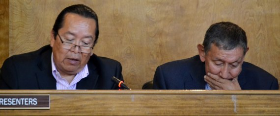 (L-R) Navajo Nation Chief Legislative Counsel Levon Henry and Ethics and Rules Office Director Venon Roanhorse report to the Council on Navajo Oil & Gas Company in the Council chambers in Window Rock, Ariz., on Aug. 11, 2014. Photo by Marley Shebala. (Please provide proper photo credit when reusing photo.)