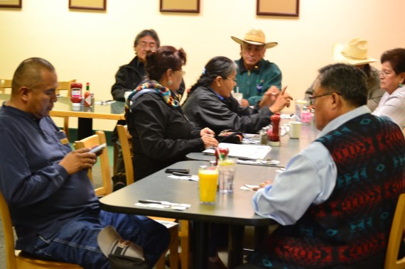 Former Navajo Election Board members meet at the Quality Inn Restaurant in Window Rock, Ariz., on Nov. 13, 2014, with a few community members. At front of photo, L-R, are Norman L. Begay and Tom M. White Jr. Sitting near Begay are Frannie George and Ruth Watson. Watson is talking with a couple of people as disqualified presidential candidate Chris Deschene's spokesperson Albert Shirley, who is wearing cowboy hat, listens. (Photo by Marley Shebala. When reusing photo, please give proper credit.)