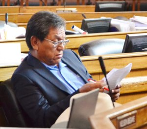 Navajo Nation Council Delegate Russell Begaye reading proposed legislation in the Navajo Council chambers on Oct. 16, 2014. Photo by Marley Shebala (Please proper credit when re-using photo.)