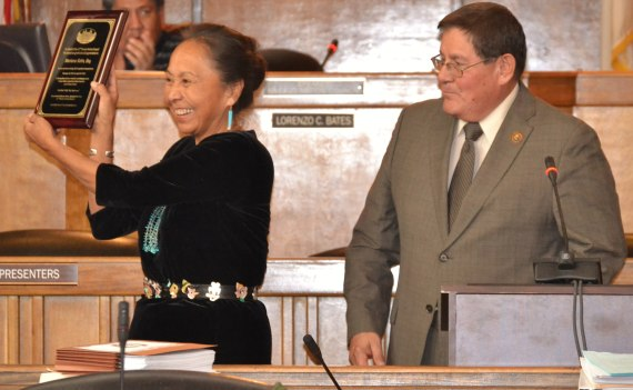 Navajo Nation Legislative attorney Mariana Kahn shows her plaque of recognition and appreciation that Navajo Council Speaker Pro Tem LoRenzo Bates presented to her before the Council special session in the Council chambers in Window Rock, Ariz., on Dec. 30, 2014. Photo by Marley Shebala. Please provide proper credit when reusing.