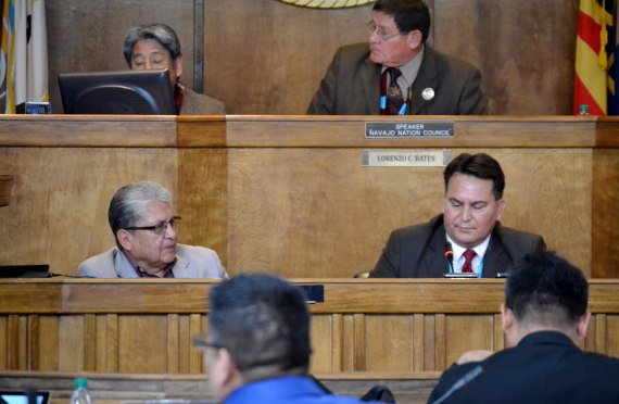 Navajo Election Office Director Edison Wauneka listens to Council Delegate Dwight Witherspoon explain why the Council needs to approve funding for the special presidential election on April 21, 2015, during the Council's special session at the Council chambers in Window Rock, Ariz., on March 13, 2015. Speaker LoRenzo Bates sits in the background. Photo by Marley Shebala.