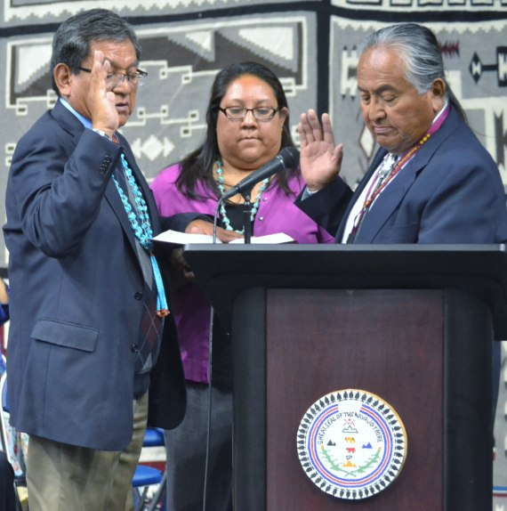 Then Navajo Nation President-elect Russell Begaye takes his oath of office from Navajo Nation Supreme Court Chief Herb Yazzie as Begaye's daughter, Karis Begaye, holds the Bible during the inauguration at the Window Rock, Ariz., High School Fighting Scouts Events Center in Fort Defiance, Ariz., on May 12, 2017. Photo by Marley Shebala (If re-use, provide proper credit.)
