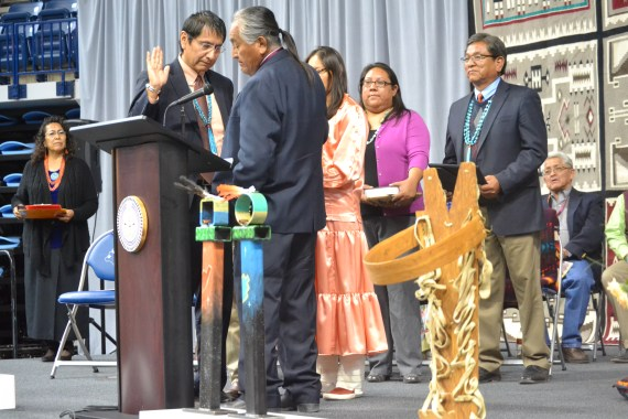 Navajo Vice President-elect Jonathan Nez takes his oath of office from Navajo Supreme Court Chief Jusitce Herb Yazzie, as his wife, stands by him. Karis Begaye and her father, newly inaugurated Navajo President Russell Begaye also stand. Photo by Marley Shebala