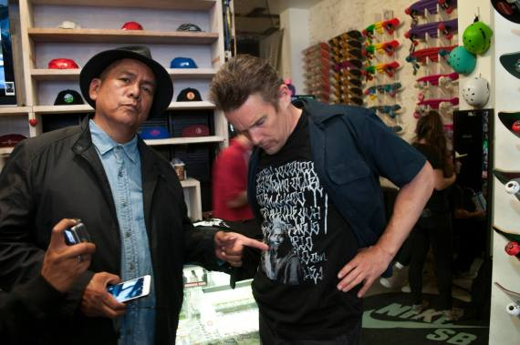 Apache artist Douglas Miles with move actor and director  Ethan Hawke, who models one of Douglas Miles' tee shirt. Courtesy photo.