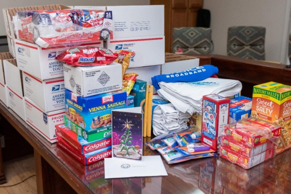PHOTO: Items included in the holiday military care packages sent to more than 80 Navajo service members in the US Armed Forces currently serving abroad include an assortment of packaged snack items, handkerchiefs, playing cards, oral hygiene products and more.