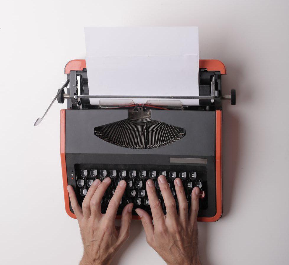 writer working on typewriter in office