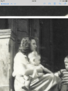 Grandmother Theda Faye holding one of her babes