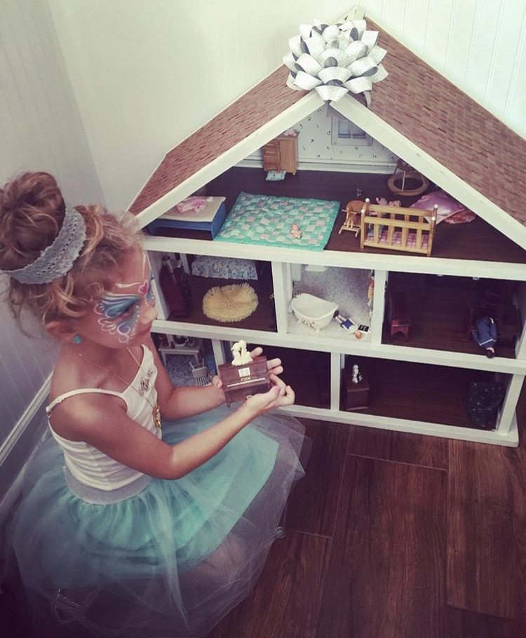 Princess in front of her Mom's Dollhouse