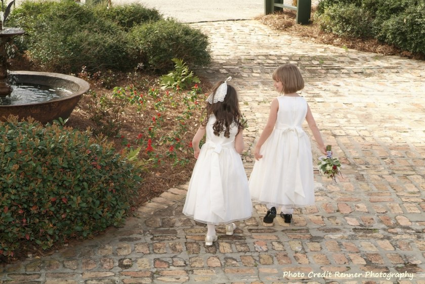 Two little girls on brick path dressed in Sunday best Old Southern Rice Dressing www.diningwithmimi.com