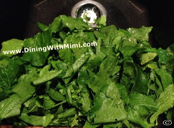 Sink filled of fresh washed Turnip Greens Jiffy Corn Muffin Mix Recipe for Jacked-Up Cornbread www.diningwithmimi.com