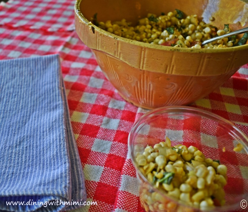 Red and white tablecloth, blue denim napkin, vintage bowl of Picnic Worthy Roasted Poblano Corn Salad www.diningwithmimi.com