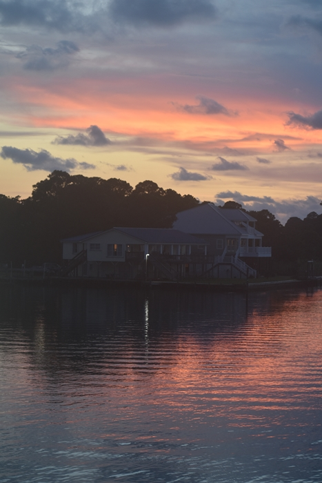 Pink and Blue sky reflected on Bay over House for Unwind on Dauphin Island www.diningwithmimi.com