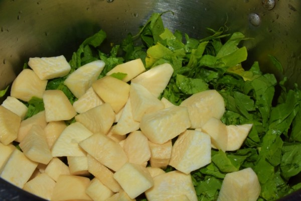 SalubriouSalubrious Turnip Greens and Roots in Stock pot www.diningwithmimi.com