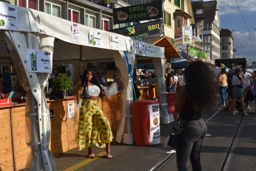 Food booths line the river in Zurich in Missing The Swiss while Jet-lagged and hoarding chocolate www.diningwithmimi.com