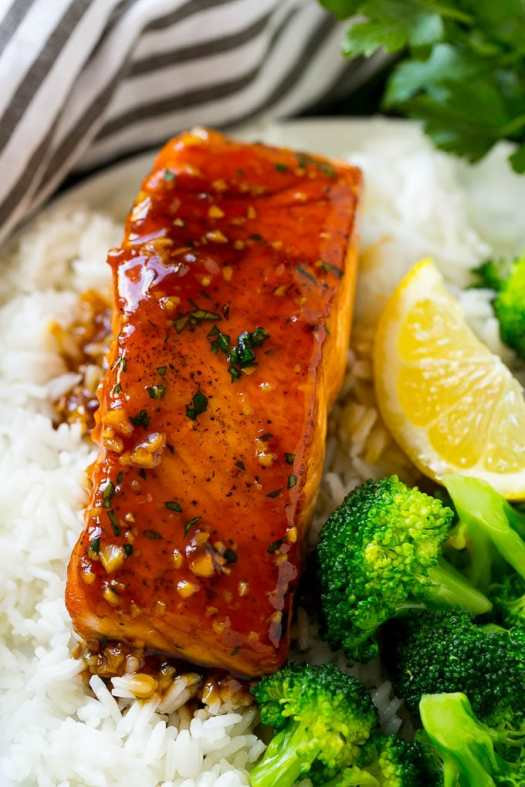 Honey garlic salmon served over rice with a side of broccoli.