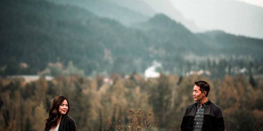 Engaged couple portrait at Cascade Locks Oregon with beautiful foggy mountains