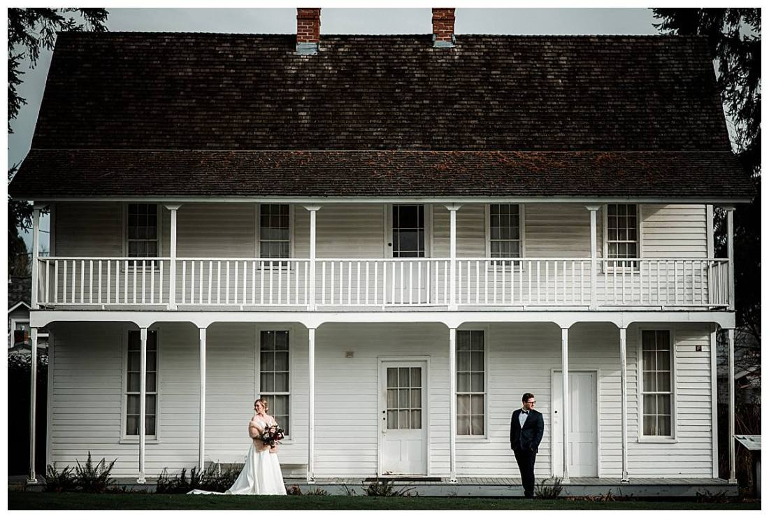 Bride and groom picture in front of a historic home on the grounds at the Willamette Heritage Center in Salem, Oregon.