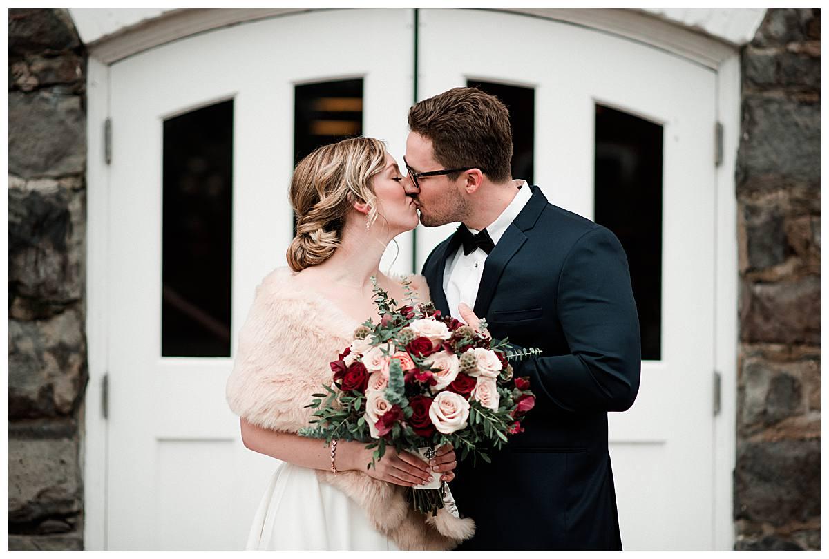 Wedding couple kissing portrait taken at the Willamette Heritage Event Center in Salem, Oregon