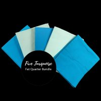 Fat quarter bundle of five hand-dyed turquoise cotton fabrics for quilters