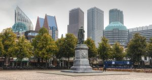 1200px-Cityscape_of_The_Hague,_viewed_from_Het_Plein_(The_Square)