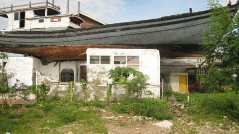 A boat is grounded on a house