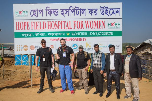Gordon Willcock (left) from Direct Relief with officials of HOPE Foundation pose for a photograph after the field visit at Madhuchara camp on January 18, 208, in Cox's Bazar, Bangladesh. Photo by Rajib Dhar for Direct Relief