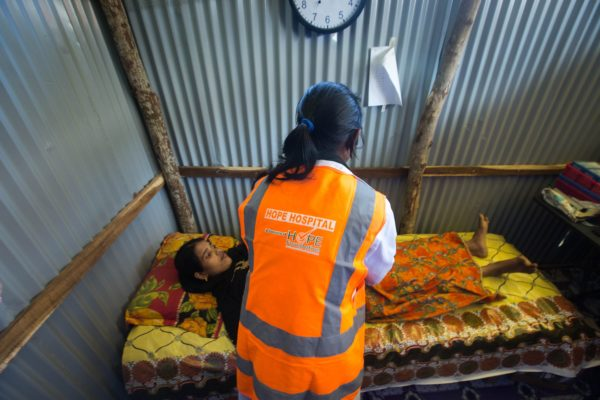A pregnant Rohingya woman is treated at Hope Field Hospital For Women in Madhuchara camp in Cox's Bazar on January 18, 2018, in Cox's Bazar, Bangladesh. (Photo by Rajib Dhar for Direct Relief)