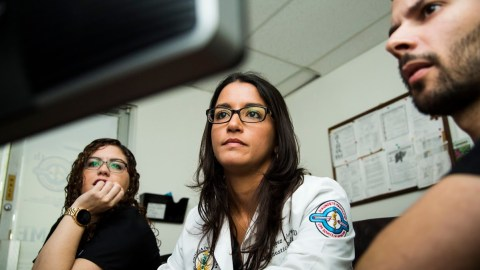 Radiologist Dr. Yania López Álvarez (center) reviews patient cases with residents Amanda Marrero González and Manuel Betancourt Robles at the Medical Center of Puerto Rico in San Juan, P.R., on May 10, 2018. Dr. López, Director of the Imaging Center of the University of Puerto Rico School of Medicine, returned to her homeland last year to work with the island's population, leaving behind generous job offers on the mainland. Doctors who work in Puerto Rico must do more with less, with budget restrictions and infrastructure still in disrepair from Hurricane Maria. Direct Relief has purchased 3D mammography equipment so that Dr. López and her colleagues can conduct contrast-enhanced spectral mammography at the center. The equipment is expected to be operational by October 2018. (Photo by Erika P. Rodriguez for Direct Relief)
