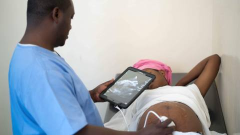 Dr. Daniel Mujarugamba performs an ultrasound at Jericho Road's Wellness Clinic. Located in Goma, the capital of North Kivu province in the eastern Democratic Republic of the Congo, the Wellness Clinic offers services ranging from primary health care to health education. Direct Relief is supporting the clinic with medications and supplies needed to provide care to vulnerable patients. (Photo courtesy of Hans Glick)
