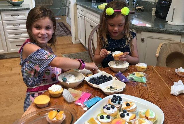 Mae decorates cupcakes with a friend in preparation for her bake sale. With a commitment to empowering girls worldwide, donated all funds raised to Direct Relief. (Photo courtesy of Patti Weber)