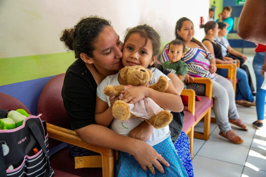 A young patient and her mother in one of Ruth Paz's waiting rooms. (Photo by Francesca Volpi for Direct Relief)