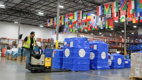 A Direct Relief staff member loads supplies, including wound care items, protective gear, and personal care products, for transport on May 23, 2019. The supplies were bound to tornado-affected communities in Missouri. (Talya Meyers/Direct Relief)