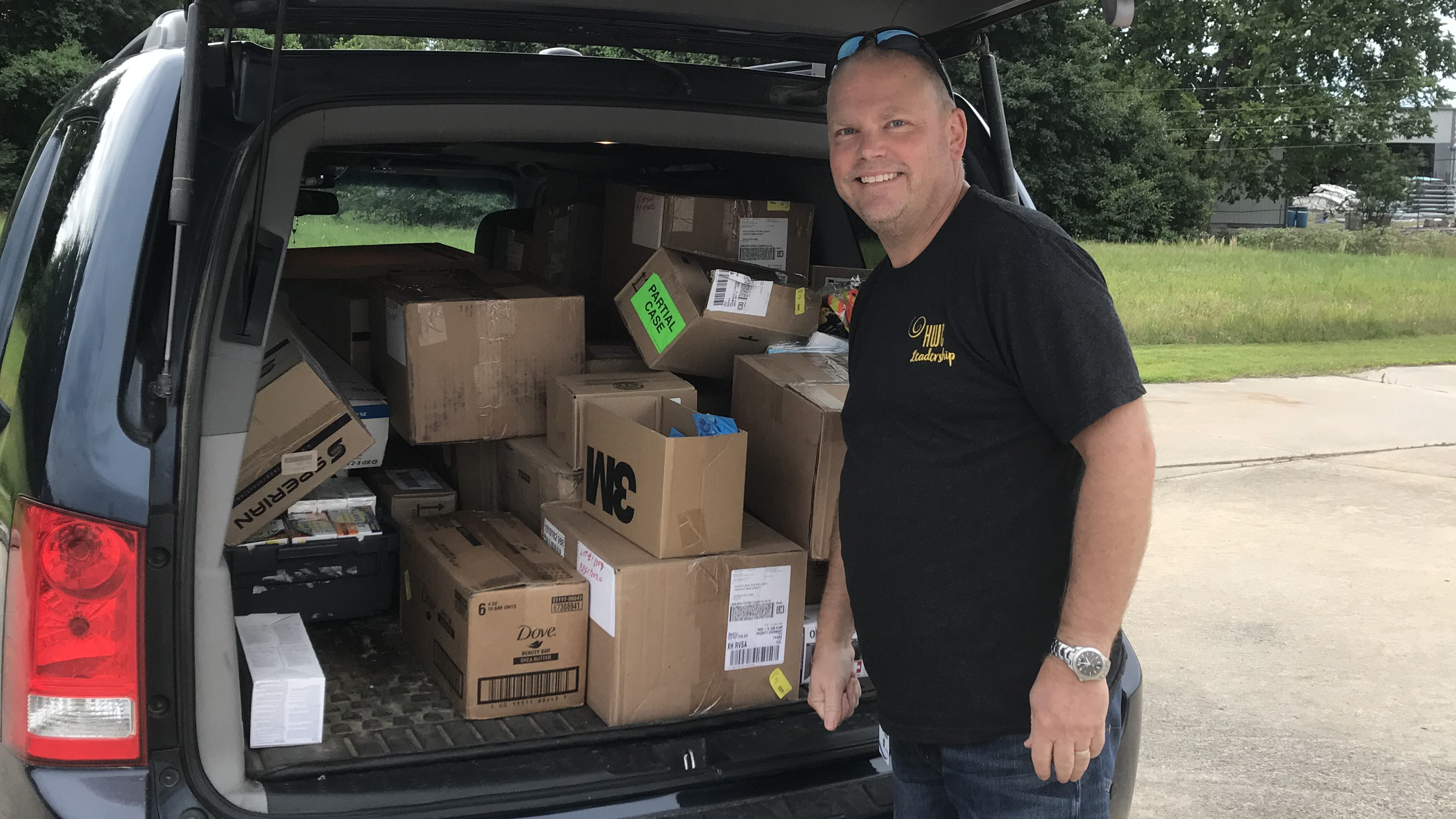 Pharmacist Byron Glover packs hygiene items and protective gear for delivery into flood-impacted communities in eastern Oklahoma. Glover and others worked to vaccinate more than 100 people against tetanus so they'd be protected during clean-up efforts. (Photo courtesy of Stigler Health and Wellness)