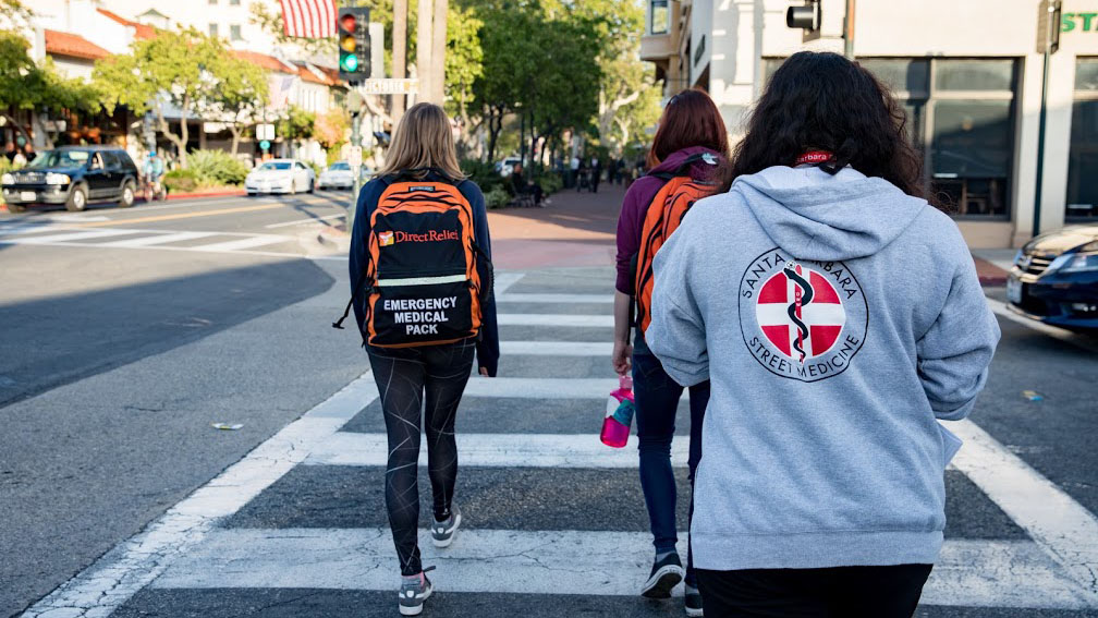 """Doctors Without Walls volunteers head out on """"street rounds,"""" searching for people who may need medical help. (Photo by Mark Semegen for Direct Relief)"""
