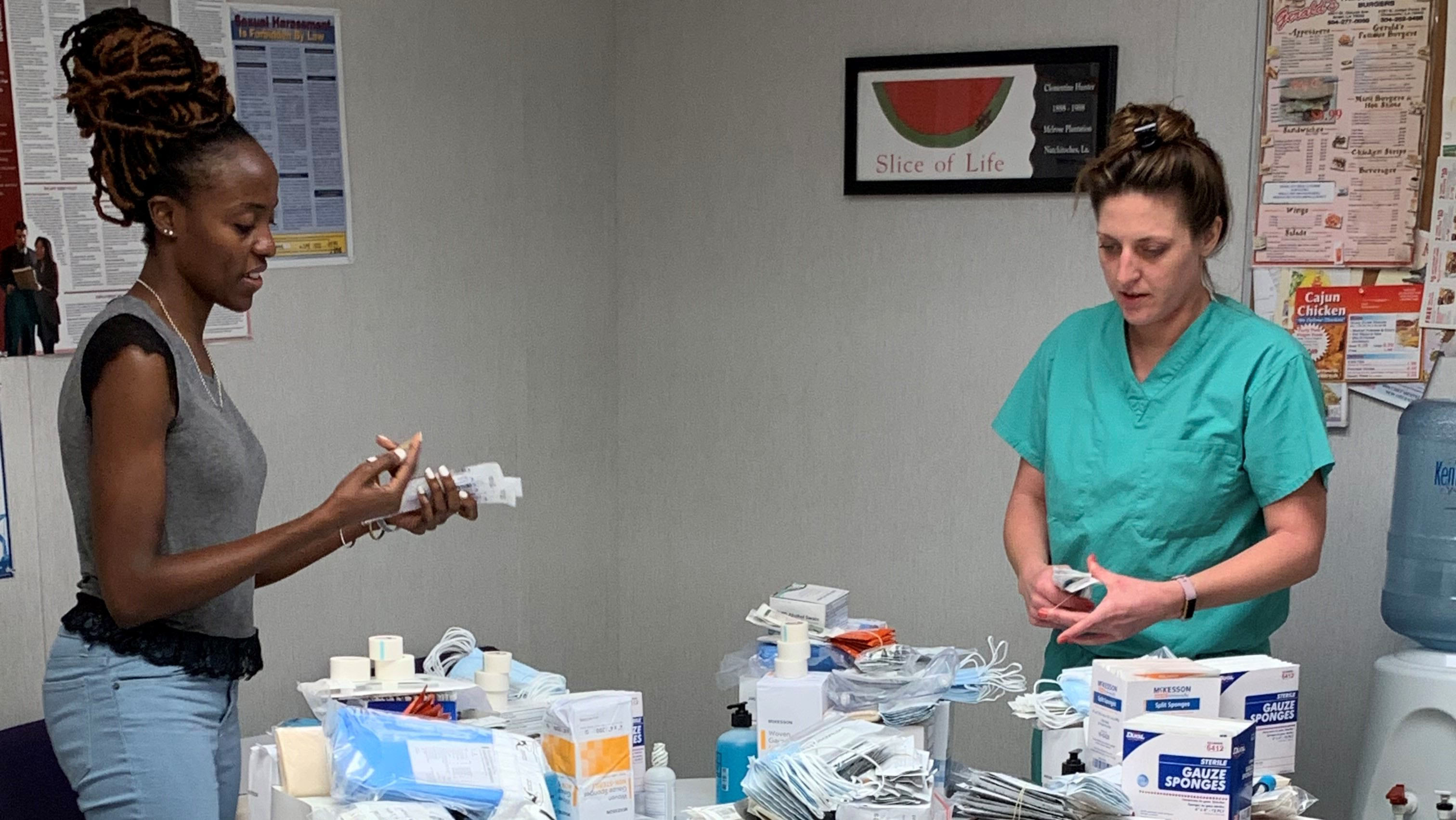 Baptist Community Health Services staff members sort medications and supplies in preparation for Tropical Storm Barry. (Photo courtesy of Baptist Community Health Services)