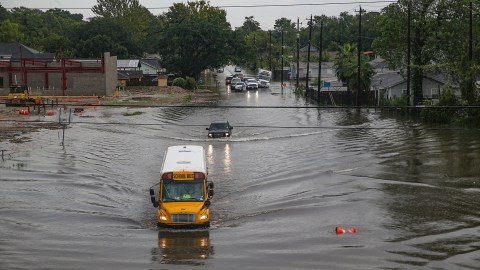 A school bus moves through a flooded roadway in Houston, Texas. Gov. Greg Abbott has declared much of Southeast Texas disaster areas after heavy rain and flooding from the remnants of Tropical Depression Imelda dumped more than two feet of water across some areas. (Photo by Thomas B. Shea/Getty Images)