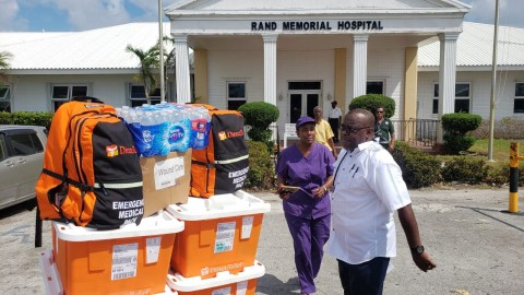Staff at Rand Memorial Hospital receive medicines on Sept. 7, 2019, in Freeport, Grand Bahama. Staff of the 86-bed hospital have been working overtime to treat patients impacted by Hurricane Dorian. (Andrew MacCalla/Direct Relief)