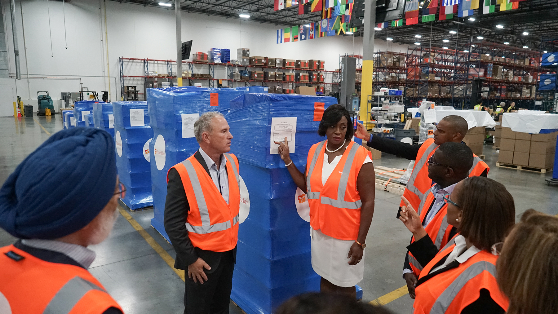 Jamaica's First Lady Juliet Holness with an outgoing shipment of medical aid departing for Jamaica from Direct Relief's warehouse. (Lara Cooper/Direct Relief)