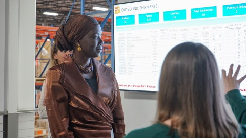 Honorary Consul General to Senegal Mame Toucouleur Mbaye looks over outbound medical shipments leaving Direct Relief's warehouse on Monday during a tour of the organization's headquarters. (Lara Cooper/Direct Relief)