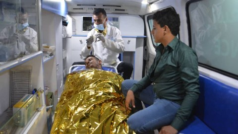 A Yemeni man receives aid in the back of an ambulance in Hodeidah. (Photo courtesy of Yemen Aid)