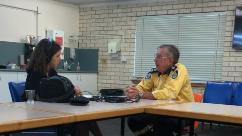 Phil Hurst speaking with Amarica Rafanelli (Chris Alleway/ Direct Relief)